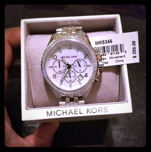 86530d0d231 Michael Kors unisex Sterling silver and diamond wa